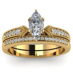 Marquise Yellow Gold Diamond Engagement Ring Wedding Set - True gold seekers will be amazed with this 14k Marquise Yellow Gold Diamond Engagement Ring Wedding Set placed in a Pave setting that features a White Marquise cut center stone with 33 White Round cut accent stones on the shank & band. The Marquise Yellow Gold engagement ring set comes with a VS2 in clarity as well as an H in color. The gem weight is equal to 1.25 carats. All of the diamonds are 100% natural. #unusualengagementrings