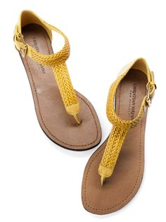 Project Runway winner Christian Siriano designed these T-straps in the season's new neutral: go-with-everything yellow. Payless.com