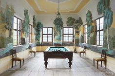 II, who lived in the castle in the 16th century. The billiard room's antique billiard table was bought at auction in Vienna, and the mural was painted in 1820.   - ELLEDecor.com