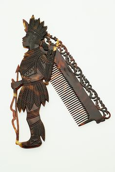 Folding comb, male Indian figure, this is cool