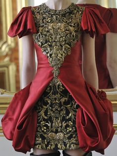 """Detail work. Love, love love.  Plus the solid with pattern underneath idea, and sleeves and """"hourglass"""" cut-out of the fabric   (Alexander McQueen Fall 2010 Runway)"""