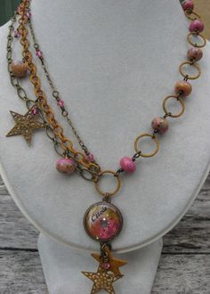 silver parrot jewelry - love her etsy shop.