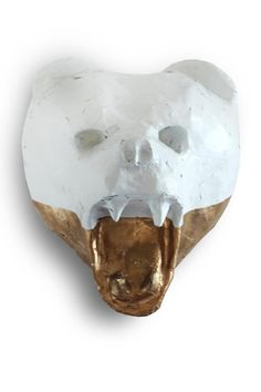"""Faux taxidermy bear head hand made by artist Jennifer Figeroa of Queens, New York. The one of a kind head is made of paper and finished in a shiny glaze. It is color blocked in white and copper gold. There is a hook on the back for easy mounting, and is light enough to hang using an adhesive wall hook.     Measures 10"""" Hx 9"""" Wx 8"""" D   Faux Bear Head by Mounted Paper. Home & Gifts - Home Decor - Wall Art New York City New York"""