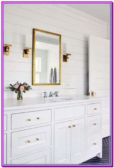 Stunning white bathroom with gold accents boasts a Restoration Hardware Rivet Mirror hung from a white shiplap wall between antique brass sconces. farmhouse bathroom amazing interior design home decor Shiplap Bathroom, Gold Bathroom, Small Bathroom, Bathroom Ideas, Neutral Bathroom, Basement Bathroom, Dream Bathrooms, Barn Bathroom, White Bathrooms