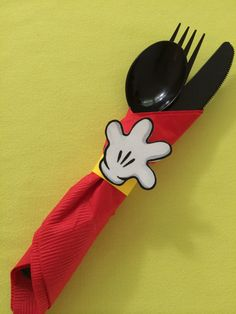 "Mickey Mouse First Birthday Party - Handi Helpers....Black plastic ware wrapped in a red napkin, ""tied"" with a yellow card stock band and topped with a Mickey hand!"