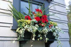 How to hang window flower boxes.