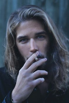 smoking long haired pretty eyed dude