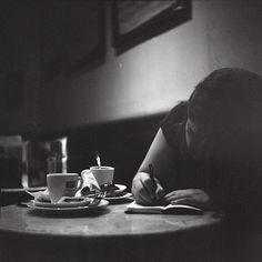 .Writing in a cafe