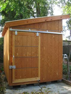 Side view showing sliding door to smaller compartment. Diy Shed Kits, Diy Shed Plans, Storage Shed Plans, Sliding Shed Door, Shed Doors, Barn Doors, Backyard Storage, Backyard Sheds, Bike Storage