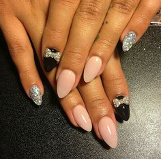 Nude, black, silver glitter, bow, almond, stiletto, acrylic nails by The Nails Queen.