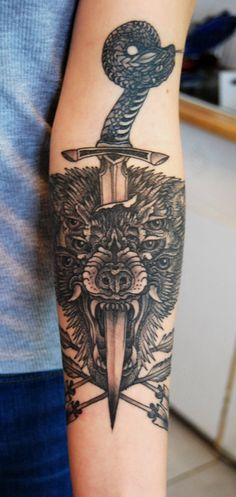 tattoo by Thomas Hooper at Saved in Brooklyn  ink, wolf, animal, sword, snake, arrows, black and white