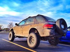 Subaru Impreza wagon lifted omg I'd totally mob around in that lol