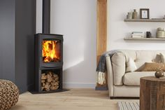 Olaf EA by Dik Geurts is a tall, freestanding wood stove with 2 heat shielded sides at the rear, suitable for room corner installation. Log shelf at the base and large viewing window. Corner Log Burner, Wood Burning Stove Corner, Wood Burner Stove, Wood Burner Fireplace, Corner Stove, Wood Stoves, Living Room Storage, Living Room Furniture, Living Rooms