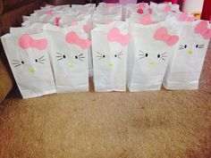 DIY birthday party goodie bags for kids treats completed. See my other post for the basic instructions. Hello kitty themed party.