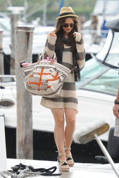 Katie Holmes channeled nautical-chic ideal for her outing on the water in a striped knit dress and lace-up espadrilles.