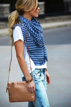 Loose ponytail, colorful scarf, neutral bag, faded jeans, white tee, Raybans and white converse.