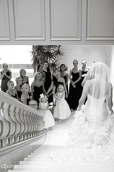 Bridal Party Photo - love this shot of the bridal partys reaction to the bride, fully dressed and ready, coming down stairs