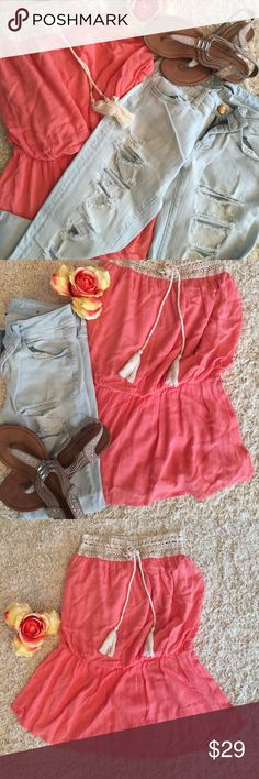NWT CORAL SLEEVELESS TOP COMPLETELY A MUST HAVE! ADORABLE AND GORGEOUS COLORS WITH THIS CREAM LACE ACROSS TOP AND CORAL COLOR FLOWING DOWN WITH ELASTIC WAIST BAND FOR ACCENT! Has cream color tassel like tie on top! Tops