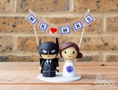 Batman groom and bride with Mr and Mrs banner wedding cake topper by Genefy Playground.  https://www.facebook.com/genefyplayground