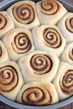 Healthier Eggnog Cinnamon Rolls -- a lightened up version with almost NONE of the fat! The perfect holiday breakfast treat. They don't taste healthy at all!