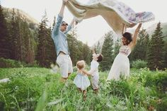 Soft and beautiful outfits. Perfect for Spring family pictures. Love the blanket too!!
