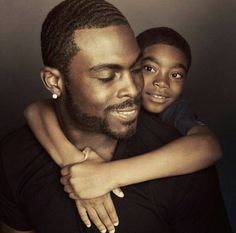 White people are not equipped to tell Black people which of our heroes and heroines we should and should not celebrate. I salute and celebrate my people on this page. Mike Vick and his son. My Black Is Beautiful, Beautiful Family, Family Love, Black Love, Black Men, Family Goals, Black Fathers, Fathers Love, Father And Son