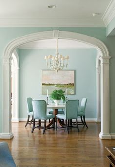 @Scarlett DeRousse i think this would be pretty separating your two rooms at the lake house-the arched opening and molding/columns & the white trim is so pretty against the blue