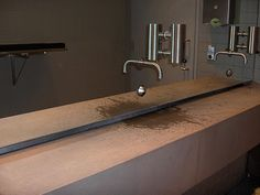 Cool sink with hidden drain where the water runs off.