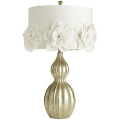 "Hayworth Rosette Lamp from Pier One on sale for $79.99.  "" Feminine fabric rosettes are anchored to its cotton shade with, appropriately, rhinestones, while a silver-leaf finish gives the sculpted base an elegant shimmer."""