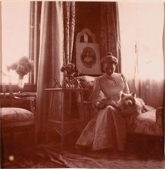 Princess Zenaida Yusupova seated in her Crimean boudior (the picture on the easel is of her younger sister Princess Tatiana Yusupova 1866-1888)