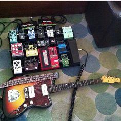 Justin Gerlach's pedalboard and guitar setup.