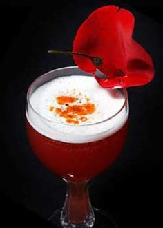 """Funny Valentine"": 1 1/2 oz Bourbon,  2 oz of sweetened chamomile tea, 4 fresh raspberries, 1/4 oz fresh lemon juice, 1 1/2 oz Mercy. Combine all ingredients, except Mercy, in a shaker with ice, shake, strain into a cognac snifter or lowball glass, then float with Mercy and garnish with a rose petal."