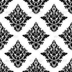 Seamless arabesque pattern with a diamond shaped floral motif in a repeat pattern in black and white suitable for textiles and wal
