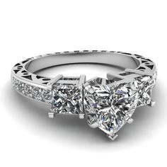 Engagement Rings - Shop heart shaped vintage 3 stone diamond engagement ring in white gold at Fascinating Diamonds. This diamond engagement ring is designed in Prong, Pave setting Heart Wedding Rings, Heart Engagement Rings, Vintage Style Engagement Rings, Beautiful Wedding Rings, Wedding Rings Vintage, Diamond Wedding Rings, Vintage Rings, Wedding Jewelry, Heart Rings