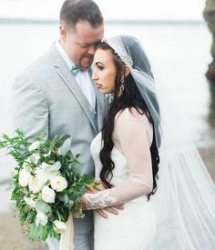 David's Bridal bride Andrea in a Long Sleeved Chiffon Sheath Wedding Dress with Illusion and Lace Neckline by David's Bridal