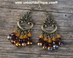 Boucles d'oreille pendantes bronze, perles en verre et toupies