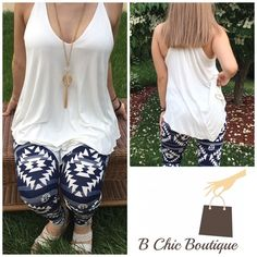 """Ivory Jersey Knit Tank Asymmetrical hem tank made of rayon/spandex blend. This listing is for IVORY  Measurements laying flat Small Pit to pit 17"""" length 27""""  Medium  Pit to pit 18"""" length 28""""  Large  Pit to pit 19"""" length 29"""" Bchic Tops Tank Tops"""