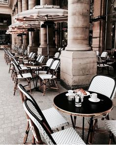 Cute Parisian outdoor cafe. White cafe chairs with cute umbrellas | jaimekrzos