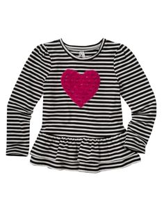 Your little girl will look adorable in this long-sleeved peplum top. The striped top features a heart applique on the chest.
