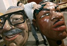 Volunteer Don Robbins cleans up Coleman Young and Joe Louis heads as volunteers and staff ready floats, costumes and props for the 81st annual Thanksgiving day parade at The Parade Company in Detroit, Michigan on November 18, 2007. (Brandy Baker/ The Detroit News)