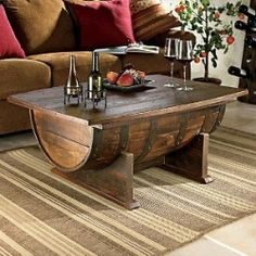 If an Irish Coffee is coffee with a drop of whiskey, this unique furniture piece must be an Irish Coffee Table! The whiskey barrel coffee table opens up for storage and features an original barrel tabletop with a rustic feel age stained base.