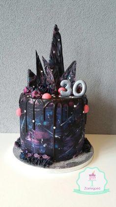 Galaxy dark drip cake