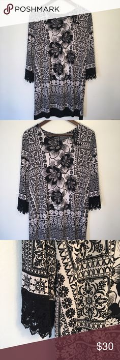 "Alfani Dress Black and white dress by Alfani. Lace accents on 3/4 length sleeves. Loose fit and oversized dress. Could fit XL. Could also be worn with leggings! Zipper in back. Length 35"", chest 22"" across. Alfani Dresses"