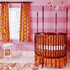 Orange baby cribs with round shape