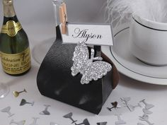 Black silk handbag wedding favour box with silver glitter butterfly