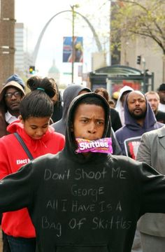 Eric Evans from St. Louis holds a bag of Skittles candy in his mouth while walking with other activists through downtown St. Louis on Friday, March 23, 2012, to bring attention to the Trayvon Martin case. Martin was unarmed when he was shot and killed in February in an Orlando, Fla., suburb. He was believed to be carrying a bag of Skittles candy and a can of ice tea with him when he was shot. Photo by Johnny Andrews, jandrews@post-dispatch.com