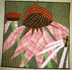Flower quilt in plaids by PJ Howard, posted at DeLane Quilts.  Fiber Art Options exhibit 2011