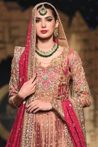 Nothing speaks of femininity and class louder than this outfit. This beautiful dress comes with burgundy A-Line frock with beautiful embellishment around the hem and vertically worked gold lines and it finished with a thick embellished border. The embroidery is done with golden, solver and antique shaded zardozi work. Furthermore it is also enhanced with […] The post Pakistani Bridal Dress – Burgundy A-Line Frock Sharara appeared first on Latest Pakistani Fashion 2020 - Formal Wear - Latest Pakistani Fashion, Heavy Dresses, Pakistani Bridal Dresses, Sharara, Femininity, Dream Dress, Fashion 2020, Formal Wear, Dress For You
