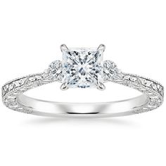 Princess Cut Bristol Diamond Engagement Ring - Platinum. This delicate vintage style three stone setting is hand-engraved with ornate nature-inspired imagery and delicate milgrain on the top and sides of the gently tapered band for a beautiful light-catch Three Stone Engagement Rings, Engagement Ring Styles, Designer Engagement Rings, Diamond Engagement Rings, Princess Cut Rings, Turquoise Rings, Diamond Solitaire Rings, Rings For Her, Eternity Ring