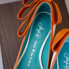 This bride's wedding shoes are imprinted with their names and their wedding date inside!